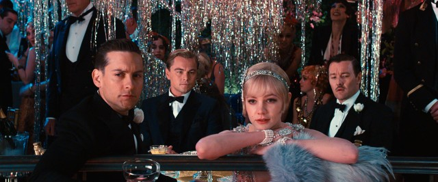 "Nick (Tobey Maguire), Gatsby (Leonardo DiCaprio), Daisy (Carey Mulligan) and Tom (Joel Edgerton) take in the sights and sounds of one of Gatsby's spectacular parties in Baz Luhrmann's ""The Great Gatsby"" (2013), #57 in our countdown."