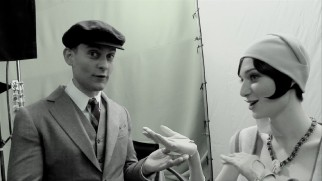 "In costume but not so in character, Tobey Maguire talks with Elizabeth Debicki in ""Within and Without with Tobey Maguire."""