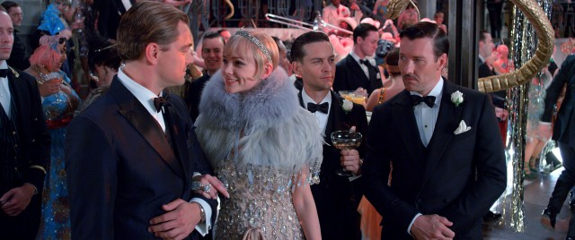 Nick Carraway (Tobey Maguire) is the fourth wheel to the love triangle involving Gatsby (Leonardo DiCaprio), Daisy (Carey Mulligan), and Tom Buchanan (Joel Edgerton).
