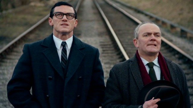 "In ""A Robber's Tale"", the first half of ""The Great Train Robbery"", mastermind Bruce Reynolds (Luke Evans, left) does some reconnaissance work on the mail train's tracks."