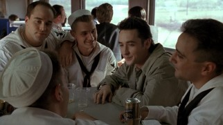 Roy Dillon (John Cusack) uses loaded dice to con sailors (including a balding young Jeremy Piven) on a train.