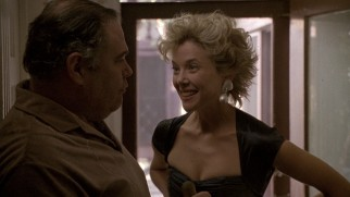 Myra Langtry (Annette Bening) uses her body to get out of paying the rent she owes to her landlord (Gailard Sartain).