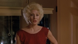 Platinum blonde Lilly (Anjelica Huston) turns to her son for help.