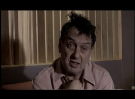 "Director Stephen Frears looks like he could use some sunlight and fresh air in ""The Making of 'The Grifters.'"""