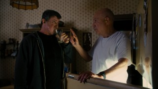 "Stallone drinks raw eggs again as Razor trains under his Mickey, Louis ""Lightning"" Conlon (Alan Arkin)."