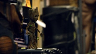 A Baby Groot is positioned on set to be filmed and replaced by computer animation in post-production.