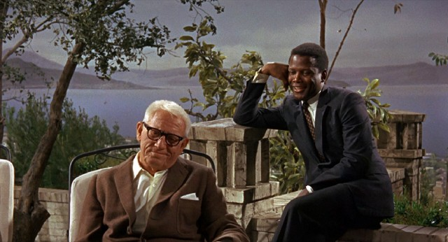 "Quigley's #1 movie star of 1968, Sidney Poitier, shares an outdoor scene with 1940's #2 movie star, Spencer Tracy, in ""Guess Who's Coming to Dinner."""