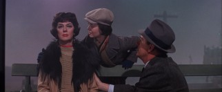 Rose (Rosalind Russell) receives life-changing news in silence at a gloomy train station.