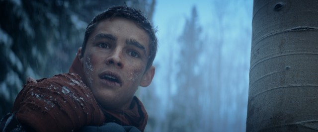 "Jonas (Brenton Thwaites) journeys to places of varied weather in the climax of ""The Giver."""