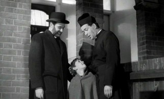 "A rabbi, a priest, and a boy... it's not the set-up to a joke, but the fairly satisfying end to ""Hand in Hand."""