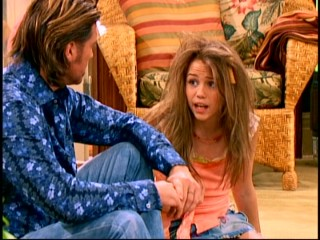 "With a French fry in her hair, Miley Stewart (Miley Cyrus) complains to her father for the very first time about the riot-inducing nature of her pop star alter ego in the ""Hannah Montana"" pilot episode."