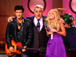 Hannah Montana's relationship with guitarist Jesse (Drew Roy) goes public on Jay Leno's Tonight Show, which means that the few old-timers tuning in who haven't nodded off before the musical guest now know about it.