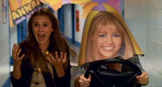 Having to break into the Hannah Montana concert, Lilly (Emily Osment) and Miley (Miley Cyrus) crash through a banner and give us the movie's best sight gag.