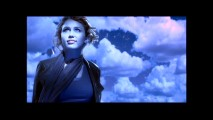 "Miley Cyrus looks up and smiles at the night sky tinting everything blue (except that unnecessary border) in her music video for ""The Climb."""