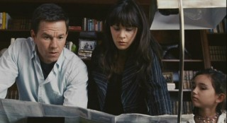 Elliot (Mark Wahlberg), Alma (Zooey Deschanel), and Jess (Ashlyn Sanchez) scour a map to determine the nearest city that has yet to be infected.