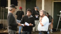 """A Day for Night"" involves Shyamalan conferring with two crew members on how to shoot a particular sequence."