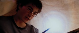 Under the bed covers, now 13-year-old student wizard Harry Potter (Daniel Radcliffe) experiments with wand control.