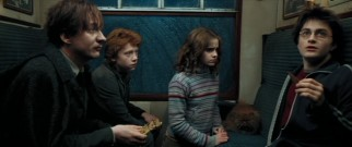 On the train to Hogwarts with friends Ron (Rupert Grint) and Hermione (Emma Watson), Harry (Daniel Radcliffe) gets a soothing piece of chocolate from new Dark Arts professor Lupin (David Thewlis) after a close encounter of the dementor kind.