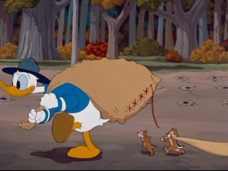 "In ""Winter Storage"", Chip and Dale stay close behind park ranger Donald Duck during his acorn-planting."