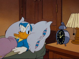 "Donald Duck has some trouble getting to sleep in ""Early to Bed."""