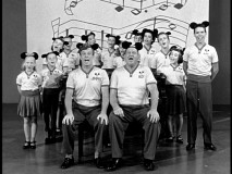 Jimmie and Roy lead a stage full of Mouseketeers in Fun with Music Day festivities.