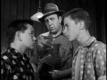 Hardy stares down Hardy, as plumber Jackley (Robert Foulk) watches on.