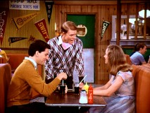 "Richie checks in on ""The Other Richie Cunningham"" (a.k.a. Potsie) and his date Winnie McKinnie (Sherry Hursey)."