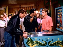 Frankie (Ken Lerner) forces Richie to make sound effects for Kenickie's (Jeff Conaway) pinball game.