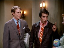 Fonzie as a door-to-door encyclopedia salesman. Customer: What volume do you recommend starting with? Fonzie: Aaaaayyyy!