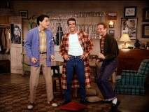 Fonzie cracks a big, wide smile as Ralph and Potsie excite him with the idea of singing.