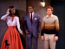 Ralph Malph (Donny Most) poses next to a 1950s mannequin couple while locked in Howard's hardware shop vault.