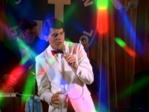 Potsie (Anson Williams) sings at the Jefferson High Senior Prom surrounded by a kaleidoscope of color.
