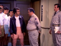 "The pants might come off, but the leather jacket stays on, as Fonzie explains to Sgt. Betchler (Warren Berlinger) in ""The Physical."""