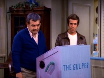 "Howard (Tom Bosley) and Fonzie (Henry Winkler) give their collaborative garbage-compressing creation The Gulper a test run in ""Fonz-How, Inc."""