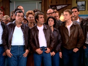 It's hard to miss the impact of Fonzie's popularity in a scene like this, where everyone in town opts for his trademark ensemble of white T, blue jeans, and leather jacket.