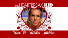 "The main menu illustrates that ""The Heartbreak Kid"" takes its title seriously with heart cursors and imagery."