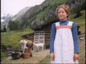 As the conflicted, guilt-ridden Grandpa works and looks on, Heidi happily smiles on her misty mountain hop.