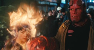 When pedestrians give Hellboy (Ron Perlman) a less-than-warm welcome, Liz's (Selma Blair) anger flares up in more ways than one.