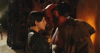 Liz (Selma Blair) and Hellboy (Ron Perlman) share a much-needed tender moment together in the midst of chaos.
