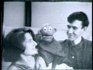 "In this vintage photo, Jim Henson and future wife Jane Nebel have fun with a puppet on the set of ""Sam and Friends."""