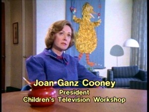 """Sesame Street"" creator Joan Ganz Cooney recalls Henson's contributions in front of a feathery Big Bird rendering."