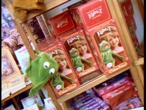 Shelves of Muppet Stuff, a Lexington Avenue boutique shop full of exclusive Muppet merchandise open from 1980 to 1993, are seen as Henson describes how commercialism must be carefully tread.