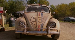 Dirty and in a junkyard, Herbie has seen better days when Maggie encounters him.