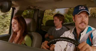 These three make up the Peyton family: Ray Sr. (Michael Keaton), Maggie (Lindsay Lohan), and in the backseat, Ray Jr. (Breckin Meyer.)