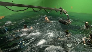 A water tank and green screen are used to recreate the 2004 Indian Ocean tsunami with which the film dynamically opens.