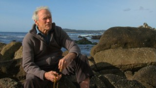 Clint Eastwood reflects on his life's work sitting on the beach rocks near his hometown of Carmel-by-the-Sea.