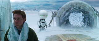 With Marvin the paranoid android looking on, Arthur tries to summon the courage to jump through the whirling portal.