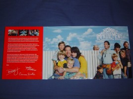 The outside of the inner case opened up to reveal some nice photos of the fam in front of a fence and blue sky.