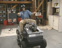 "Tim has fun on the souped-up lawnmower in ""Mow Better Blues"""