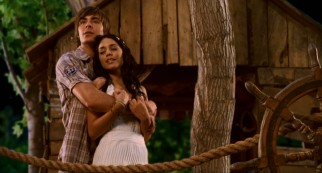 "Troy and Gabriella (real-life Zanessa couple Zac Efron and Vanessa Hudgens) pose for what appears to be a paperback cover called ""Treehouse Romance."""